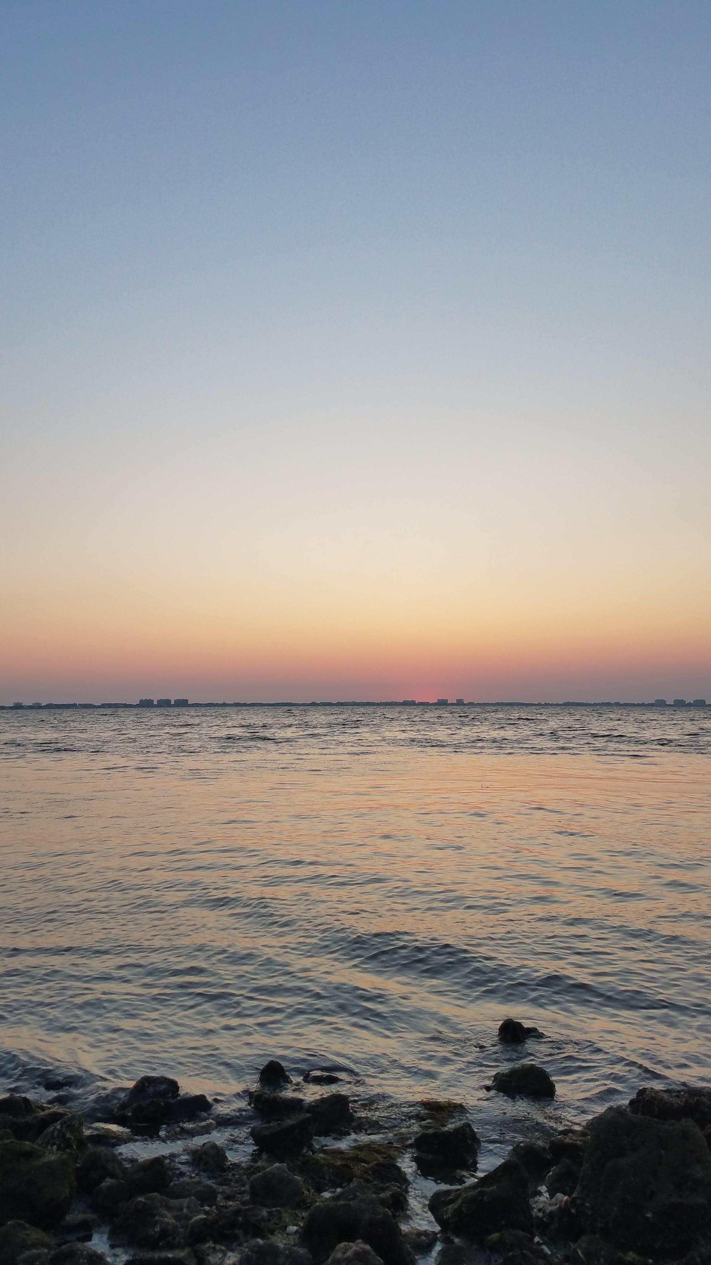 Kostenloses Stock Foto zu #sunset #florida #water #light #warm #ocean