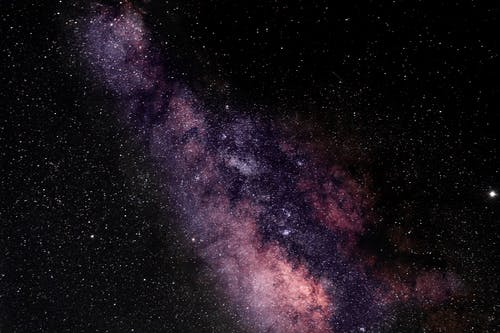Universe filled with stars nebula and glowing Milky Way