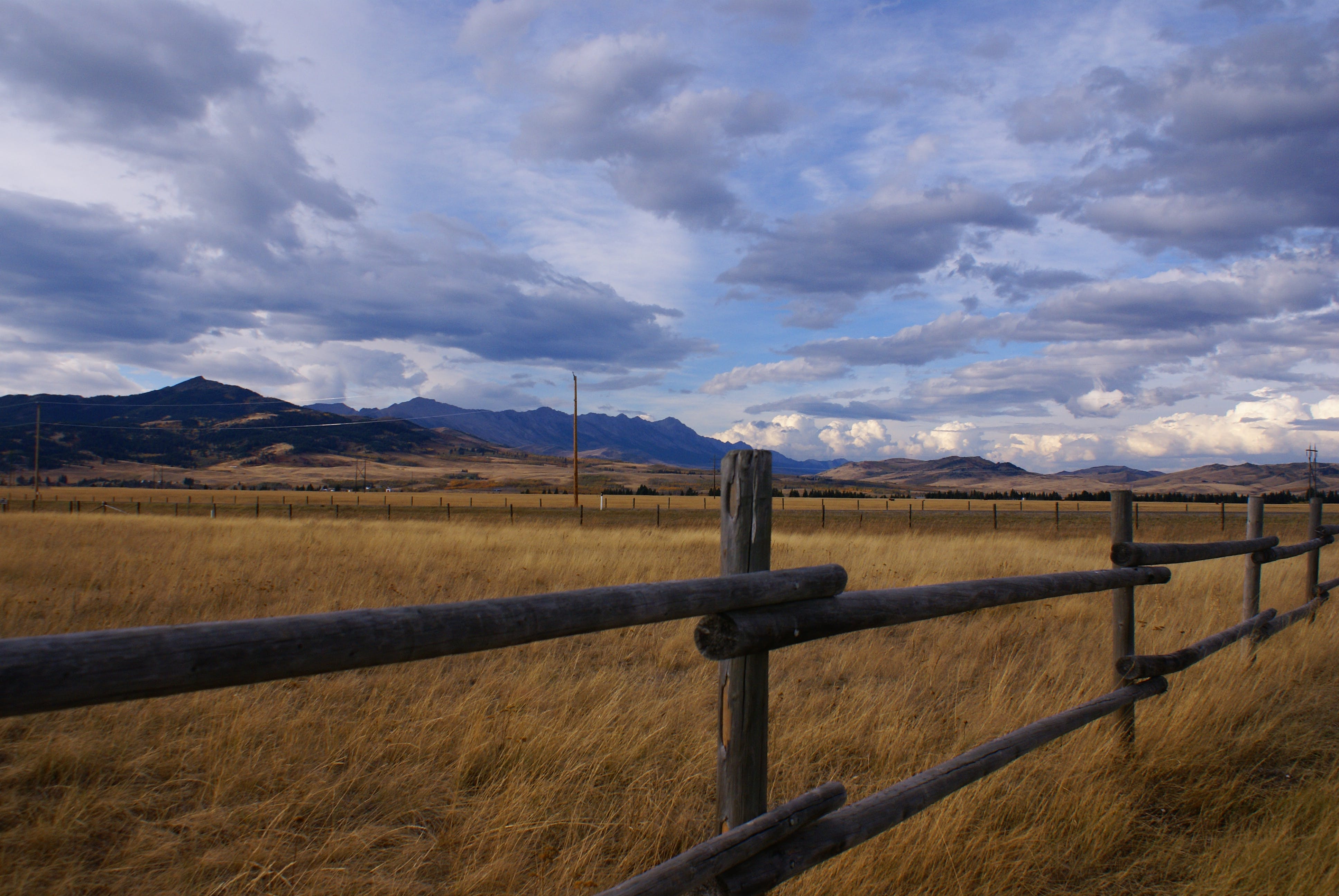 Free stock photo of clouds, Fence line, grass field, hills