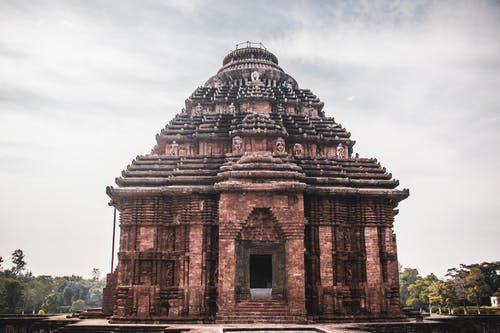 Facade of ancient Hindu temple with ornamental decor