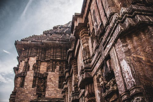 Exterior details of ancient Hindu temple decorated with carvings