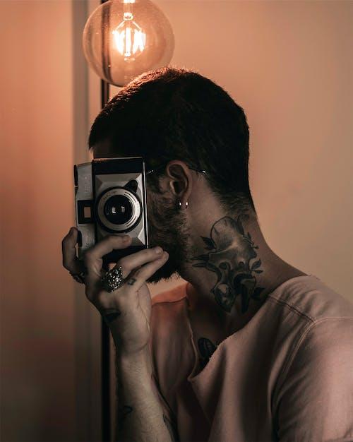 Foto profissional grátis de abertura, câmera, câmera analógica