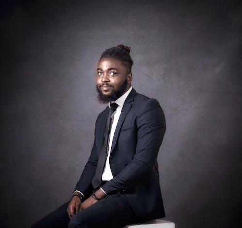 Man in Black Suit Jacket on a Studio Shot