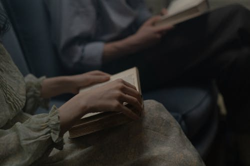 Selective Focus of People Reading Book