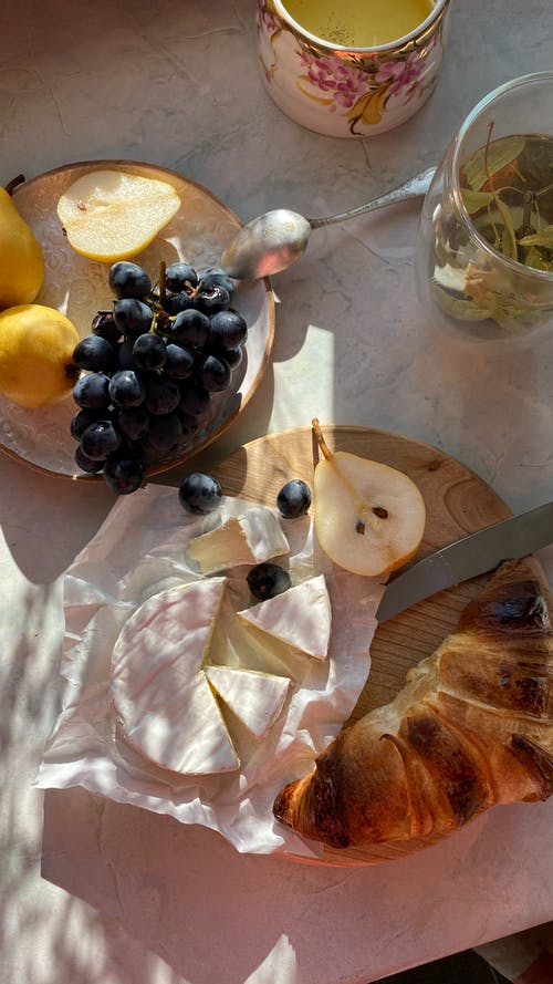 Delicious desserts and fresh fruits on table at home