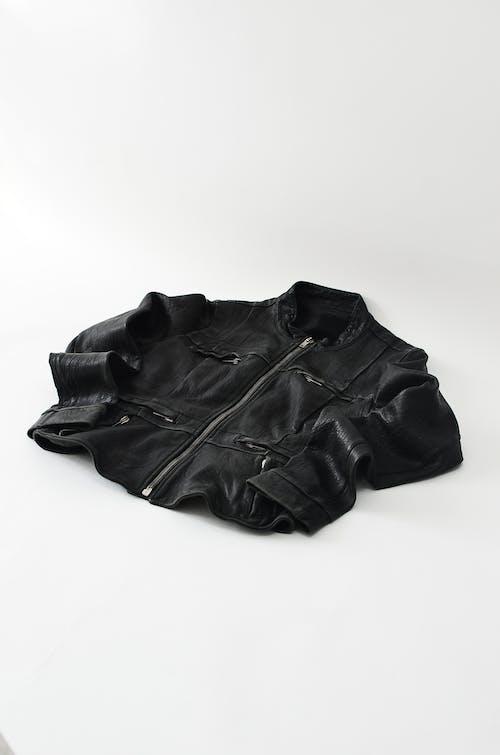 Modern black leather jacket on white background