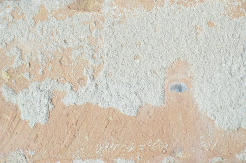 Abstract background of aged wall with ragged surface