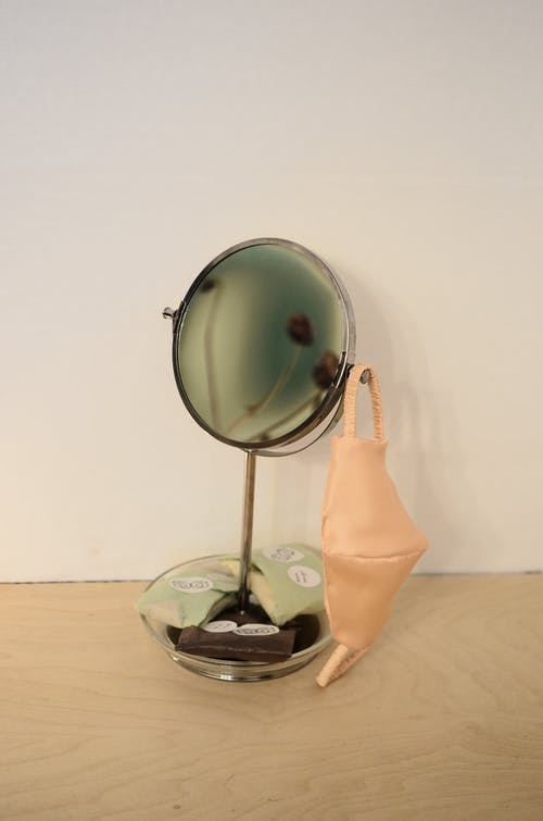 Reusable face mask hanging on table mirror