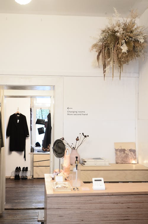 Interior of modern light clothes shop