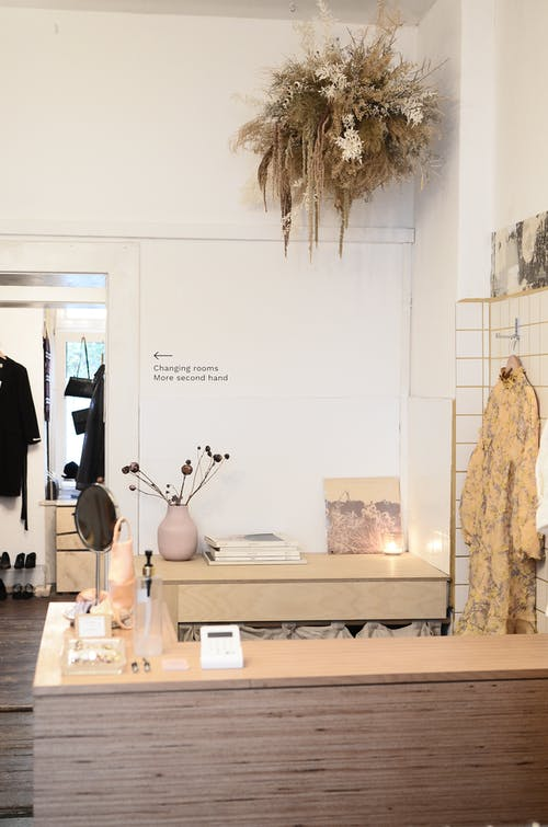 Interior of modern clothes shop with counter