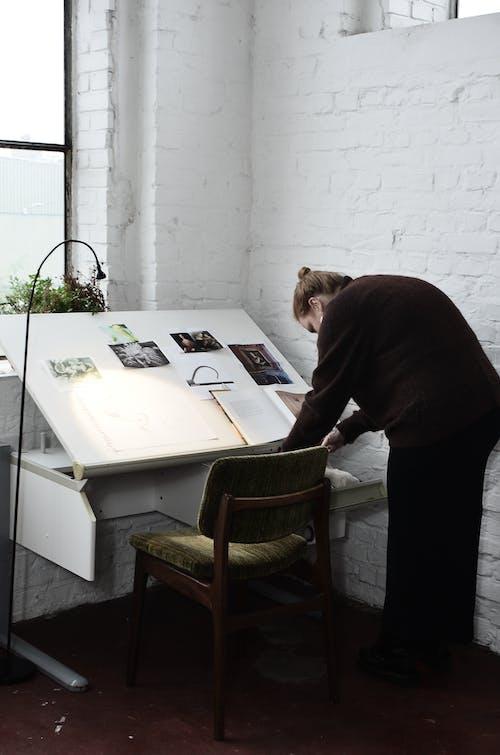 Woman preparing for work in workshop