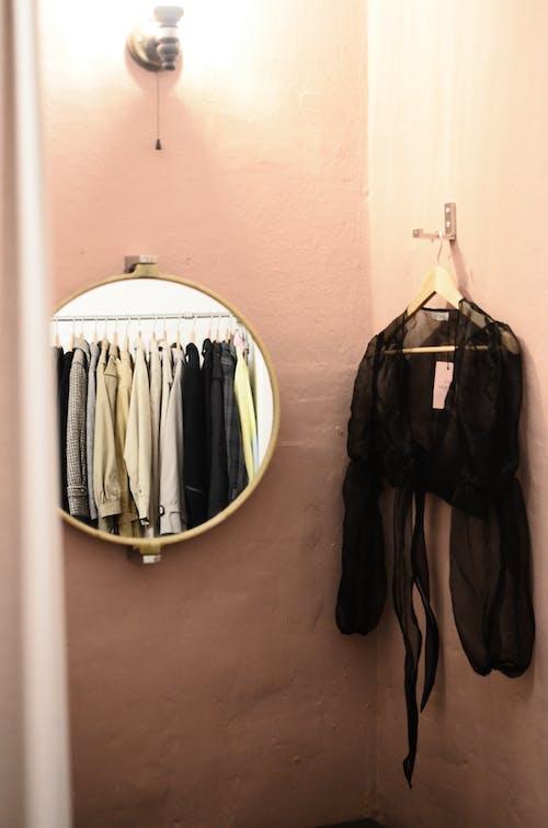 Wardrobe on hanger reflecting in mirror