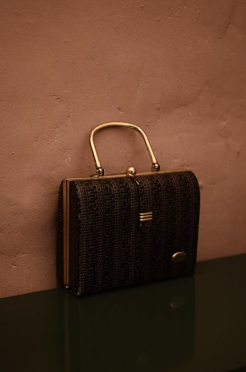 Old fashioned handbag with metal handle