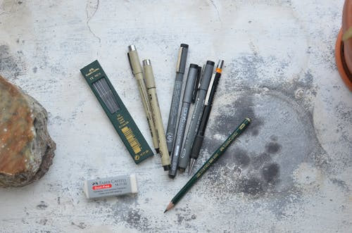Pencils and pens for art in workshop