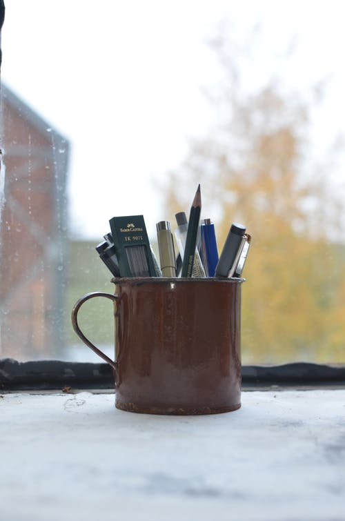 Mug with pencils and pens for art in studio