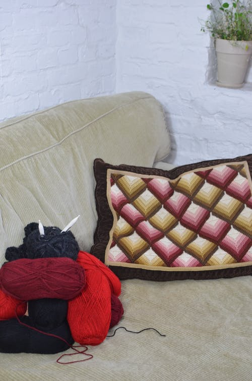 Sofa with woolen thread and knitted pillow