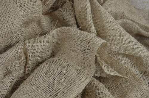 Textured background of organic sackcloth with tiny holes