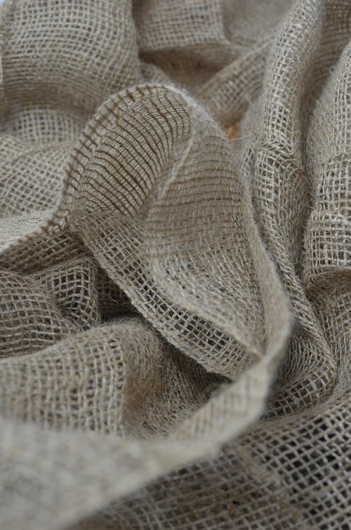 Textured backdrop of eco sackcloth with crumpled surface