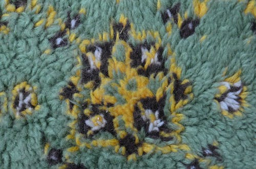 Top view closeup of textured background representing carpet with creative decor on soft surface in daytime