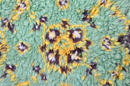 Top view of textured backdrop representing soft rug with bright symmetrical decor in daylight