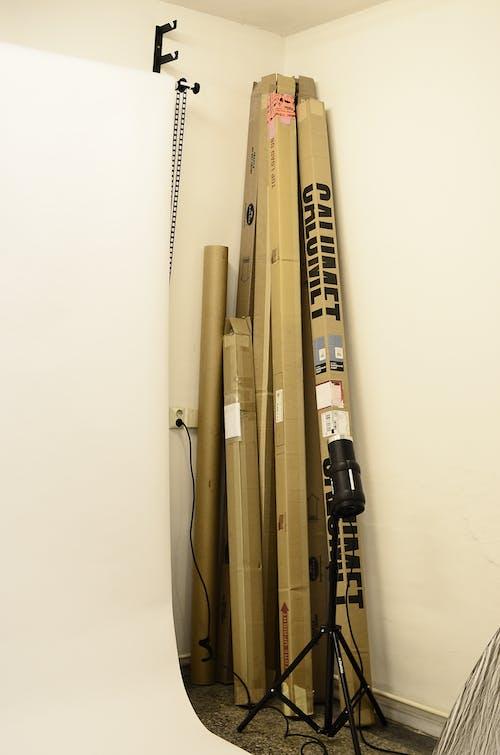 Equipment in cardboard box placed in corner in studio