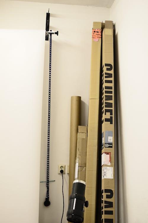 Photo shoot equipment in cardboard boxes in studio