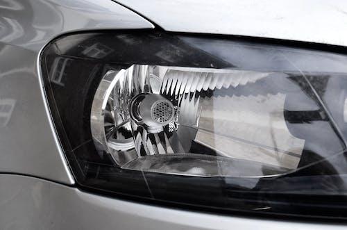 Shiny headlight of modern metallic car