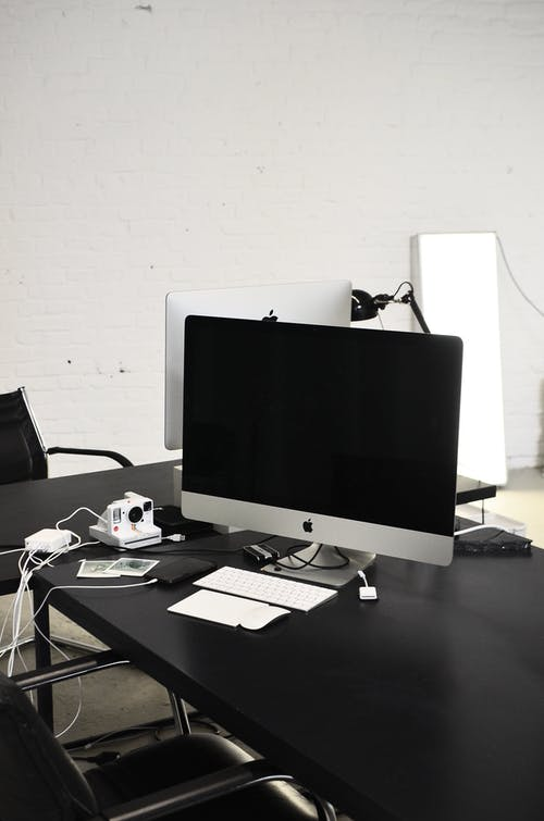 Modern convenient computer place on black table in office