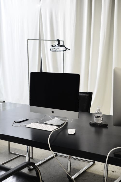 Modern workspace with computer and smartphone on table