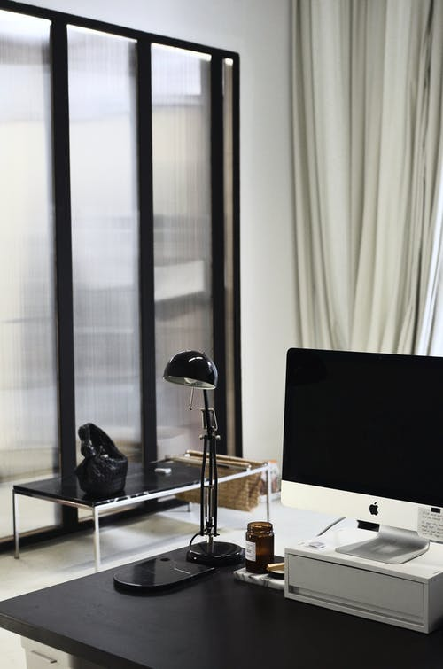 Contemporary computer placed on table in office