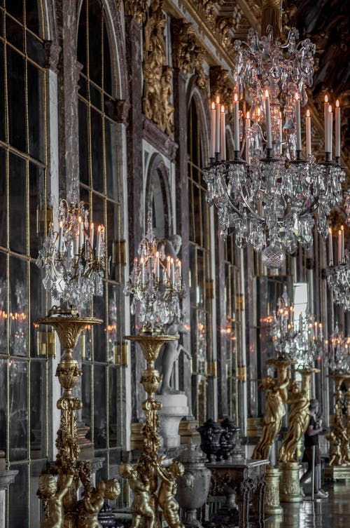 Photo of Candelabras and Chandeliers Inside a Palace