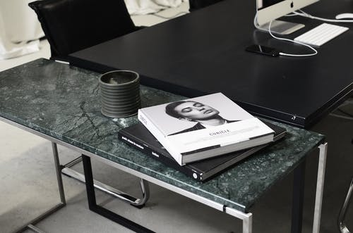 Workspace with modern devises and books