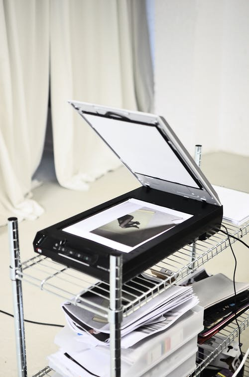 Modern scanner placed in light room