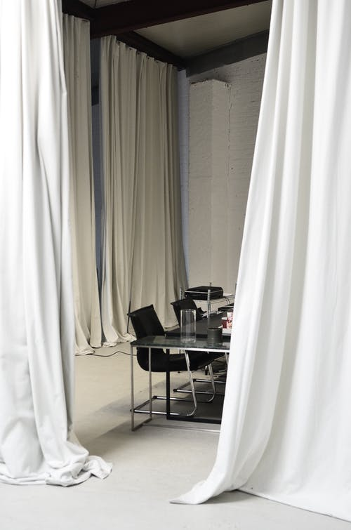 Conference room with meeting table surrounded by curtains