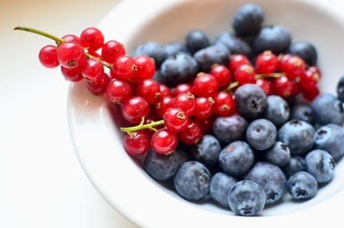 Heap of fresh berries on table