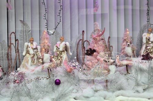 Various dolls on showcase of shop