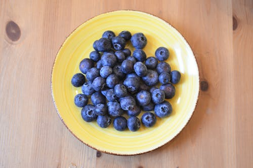 Delicious blueberry on yellow ceramic plate