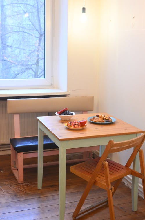 Simple dining room with various food on table