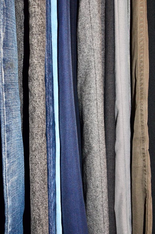 Collection of multicolored textile in wardrobe