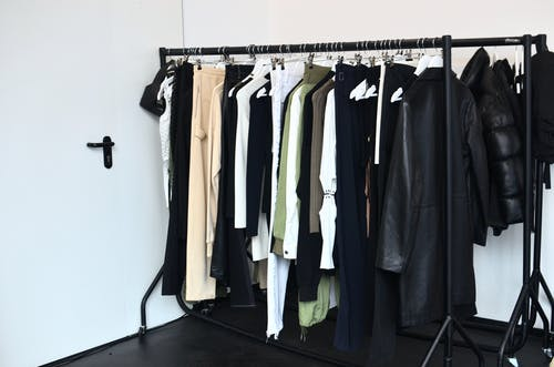 Collection of garments hanging on rack
