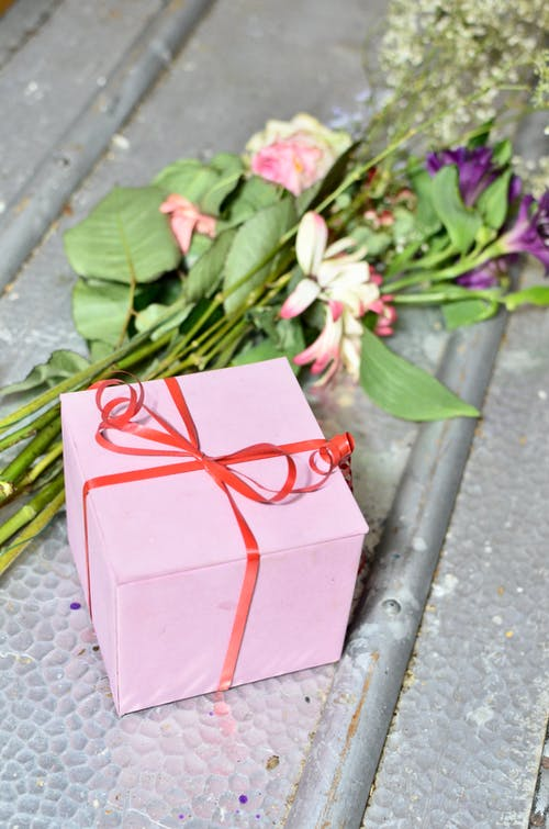 Gift box with bouquet of flowers