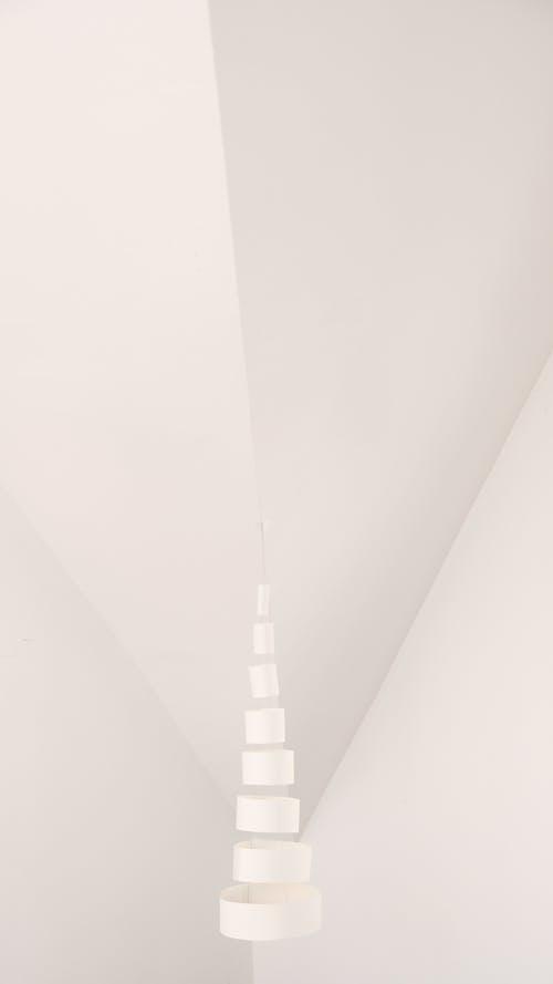 Geometric white round shaped object near wall
