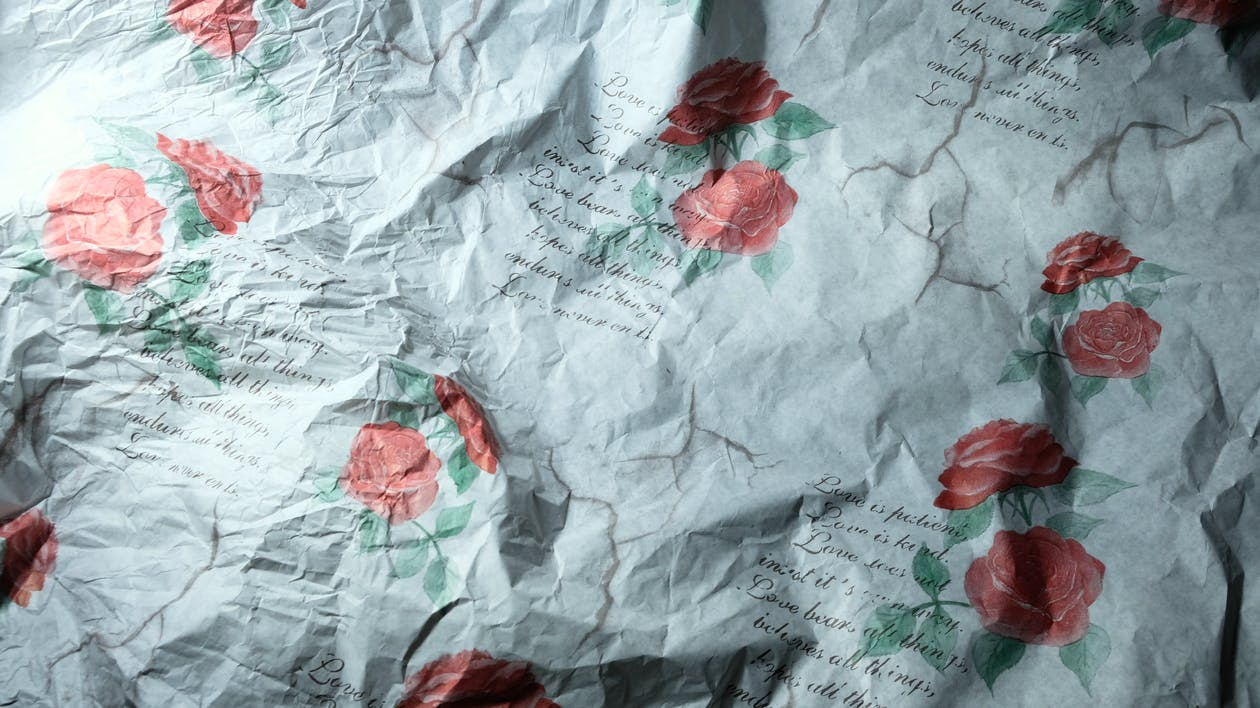 Crumpled paper with pattern of roses