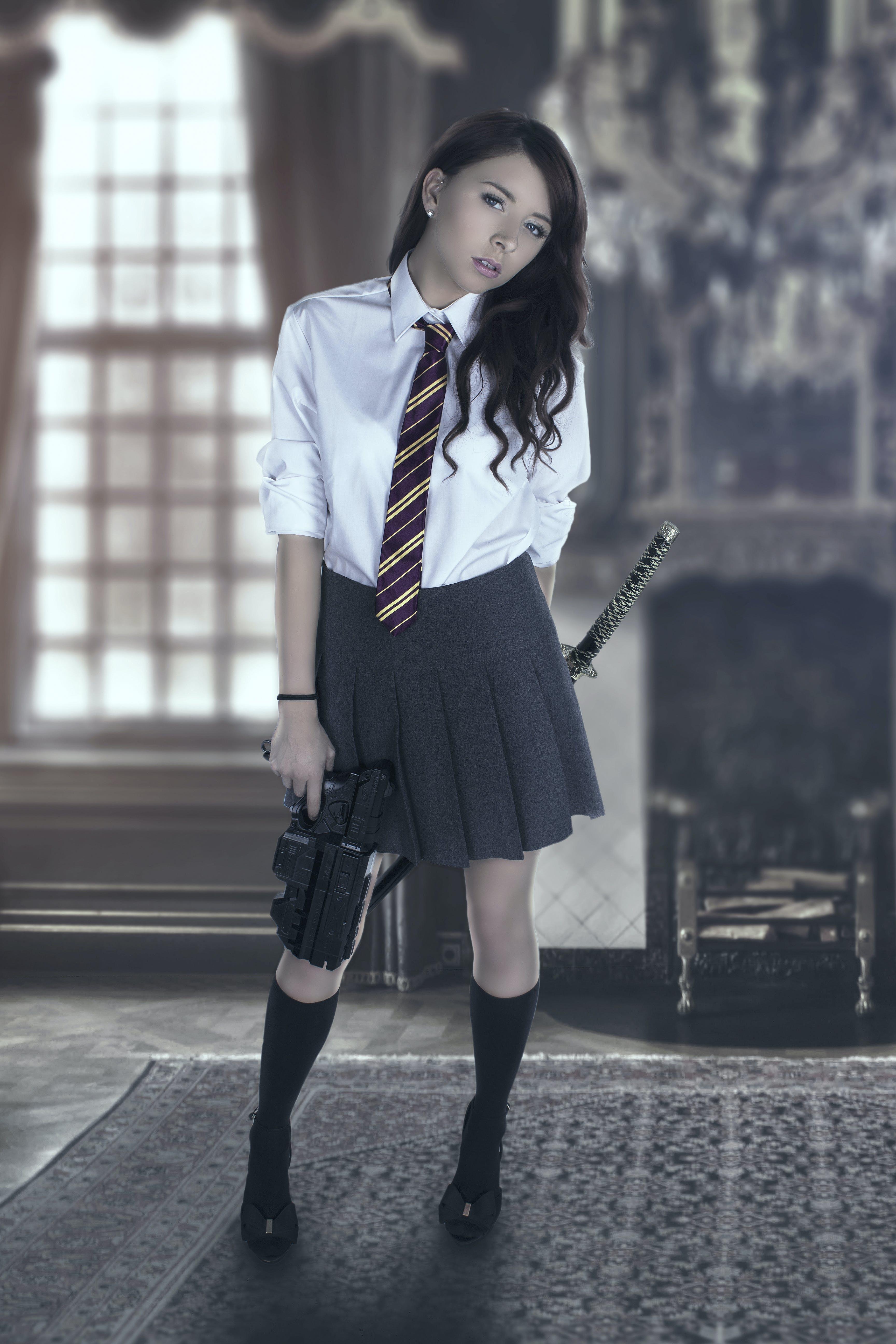 Free stock photo of gun, school girl, skirt, standing pose