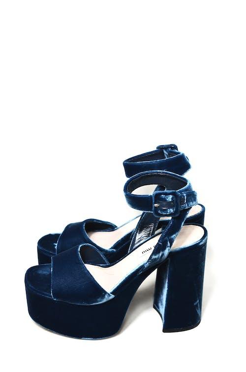 Stylish blue shoes in modern studio