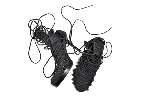 Modern stylish pair of shoes with long lacing