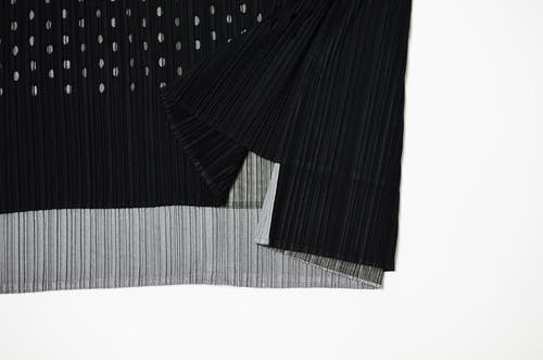 Part of stylish cloth with stripes and dots on white background in studio