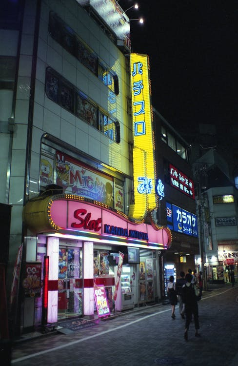 Illuminated street with glowing buildings at night