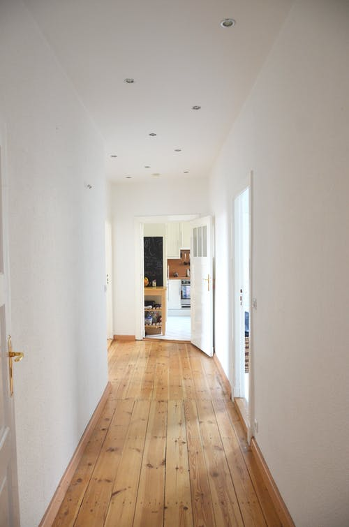 Long hallway with parquet in residential building