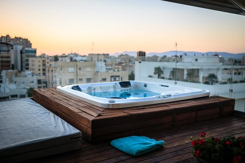 A Jacuzzi on the Balcony Overlooking the City